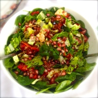 Salad, sun dried toms, goat cheese, pomegranate and roasted pepper